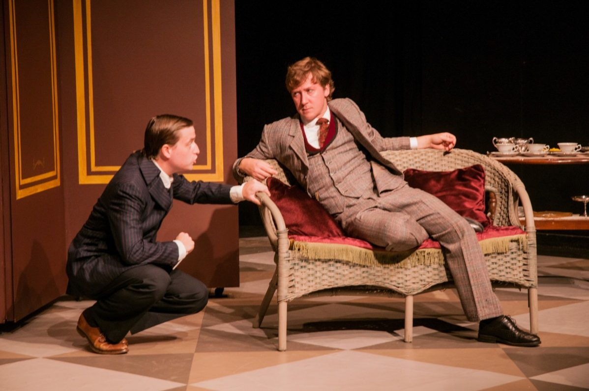 Sean Jacklin (Algernon) plays alongside Nicholas Koy (Jack) in The Importance of Being Earnest at the Alumnae Theatre. Photo by Bruce Peters
