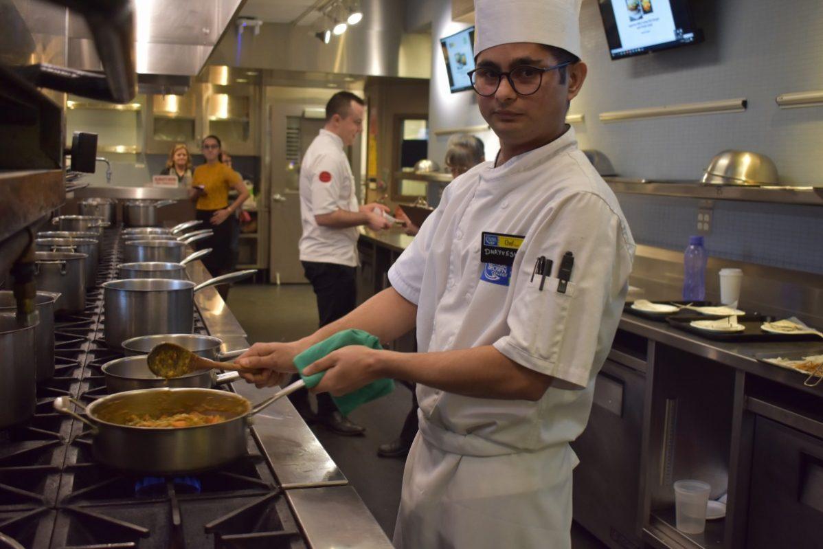 Dhayvesh Sidhpura preparing his dish. Photo: Ladshia Jeyakanthan / The Dialog