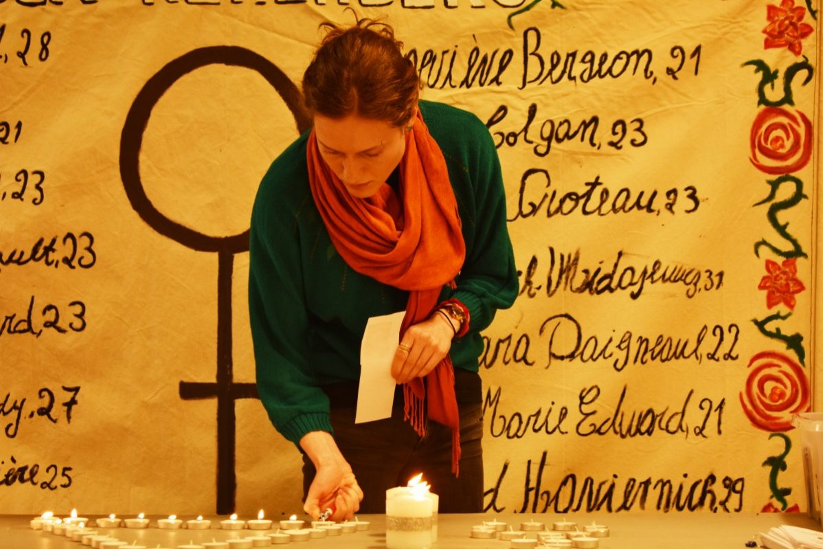 Sarah Alvo lights a candle in memory for Canada's fallen sisters at George Brown College on Dec. 3, 2018. Photo: Nico deVeber, / The Dialog