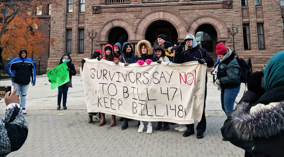 On Nov. 10 the 5 Days for Survivors: March for Work Rights for Survivors of Sexual Violence gathered in front of the Legislative Assembly of Ontario to march for the retention of Bill 148, the Fair Workplaces, Better Jobs Act. Photo: Luke Zurcher / The Strand