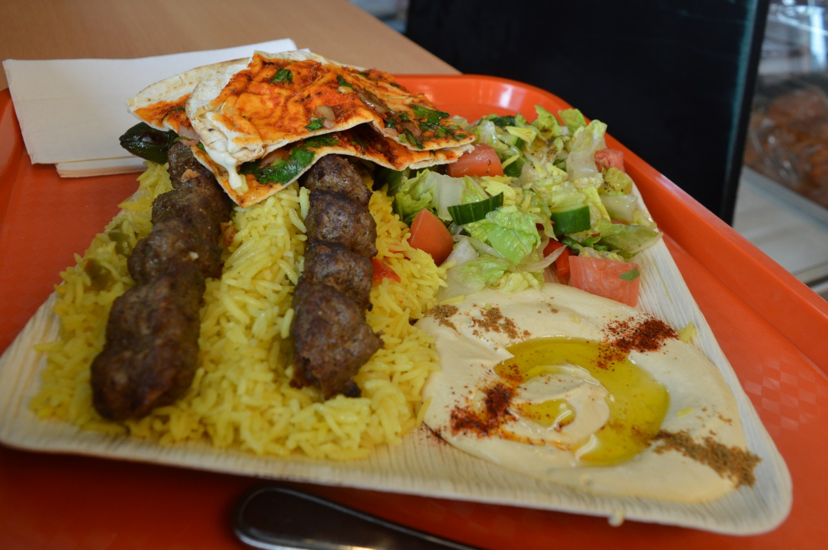 Aleppo kebab with rice, hummus beiruti and salad. Photo: Ladshia Jeyakanthan / The Dialog