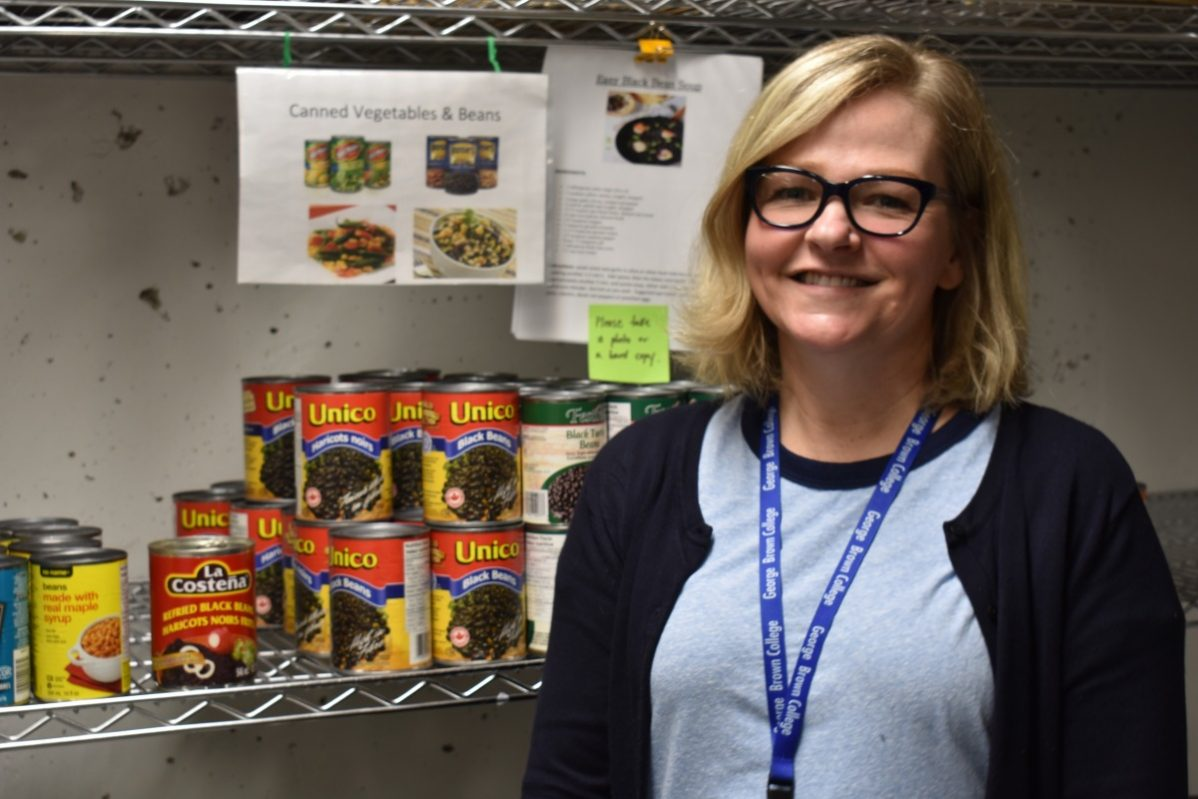 Darcy Mallany works at the Student Association food bank at George Brown College, which has seen a 67 per cent increase in visits since 2017. Photo: Luiz Felipe Lamussi / The Dialog