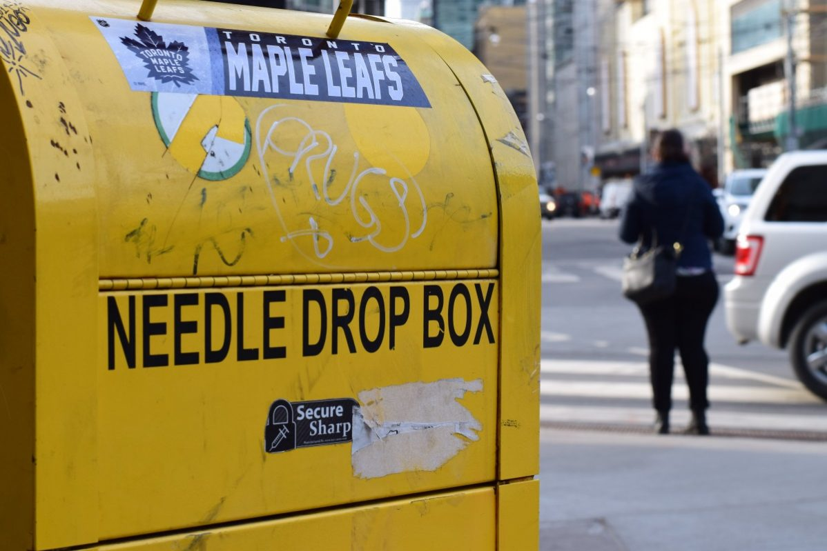 A needle disposal box outside the Works which is a needle exchange program located at 277 Victoria St. Photo: Timo Cheah / The Dialog